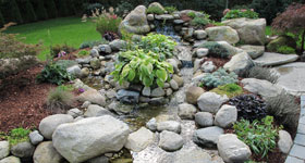 water feature with waterfall and stone bed